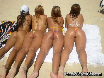Luscious teen girlfriends shows perfect butts on the beach
